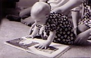 2006-Baby_reading_photo.jpg - 8729 Bytes